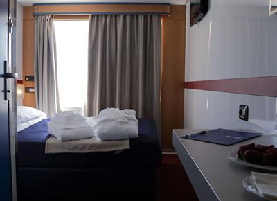 Cabin onboard SNAV ferry