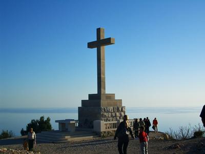 The cross on the top of Mount Srdj
