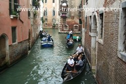 A canal with gondolas in Venice